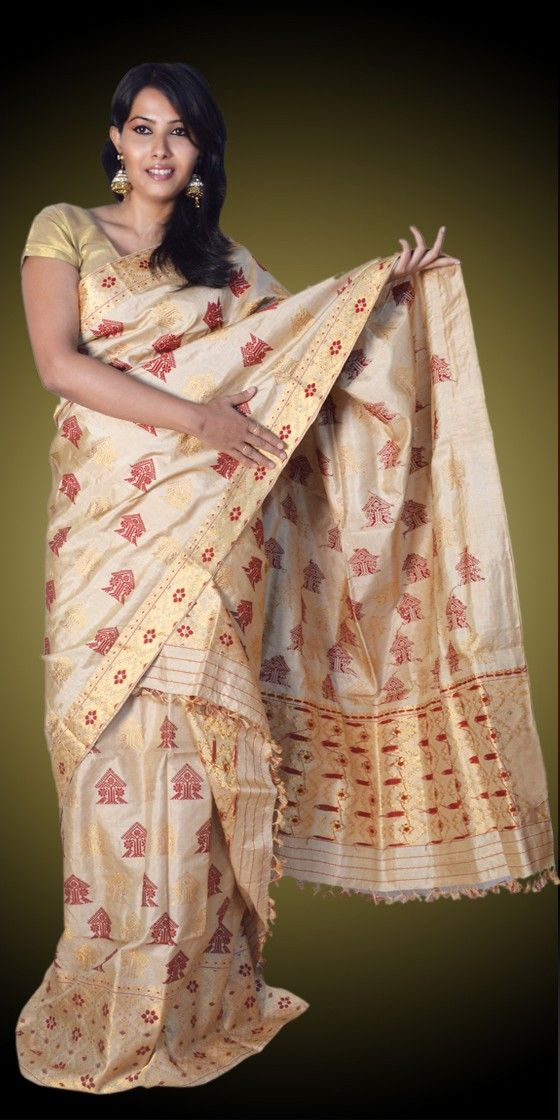 Beautiful Golden colour Assam silk  Muga Tassar Mekhla Chadar with artistic Guna and Suta work giving a gorgeous look to it. This eye-catching collection is perfect for any festive occasion.The Mekhla Chadar comes with matching blouse piece, the blouse shown in the image is just for display purpose.