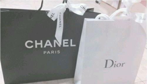 Chanel & Dior black and white twitter header
