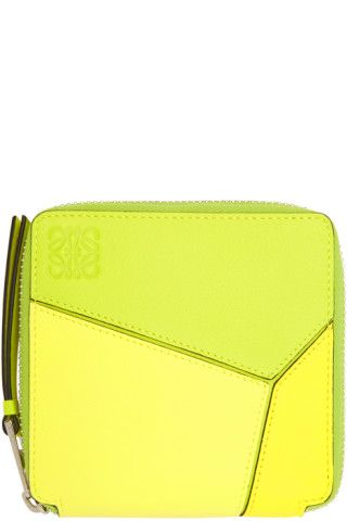 Grained leather bifold wallet colorblocked in tones of yellow and light  green. Logo embossed at face. Signature seams at front and back faces. Zip  closure. 50ec669821