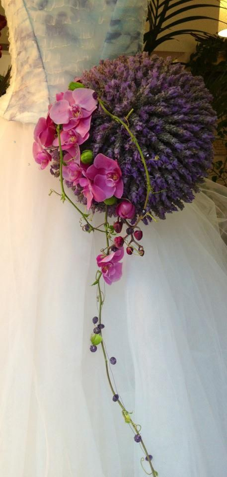 Bridal bouquet of lavender and phalaenopsis orchids.