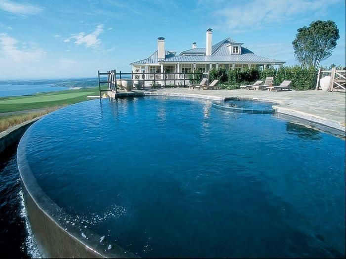 Lodge at Kauri Cliffs, Matauri Bay, New Zealand. The lodge also has one of the top-rated golf course in the world, along with amazing ocean views and impeccable staff service. You'll live like a prince with the infinity pool and multi-room houses. As the top resort by Conde Nast Traveler, your vacation doesn't get better than this.