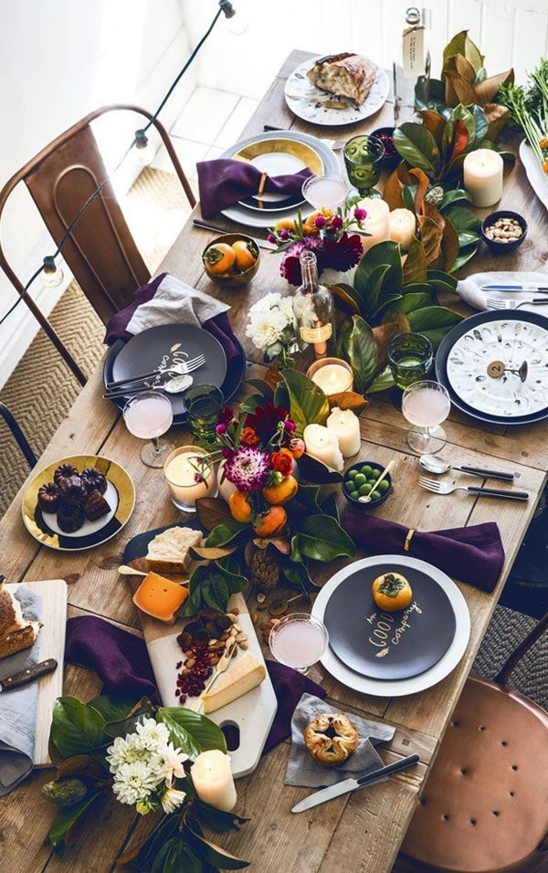 Purple gold and green tablescape! Rustic, casual, greens, few flowers but food and leaves as centerpieces.