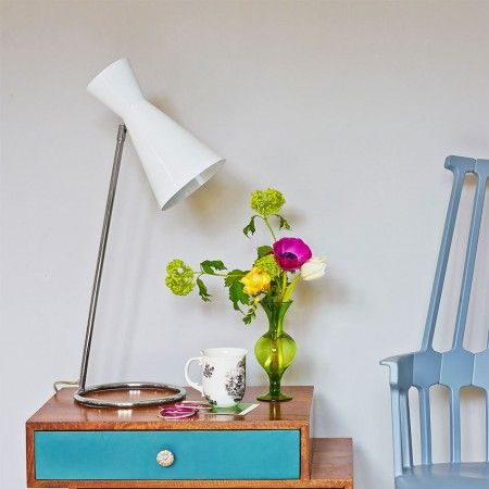 What about a pair of these as bedside table lamps.  They would look great against the pink walls.
