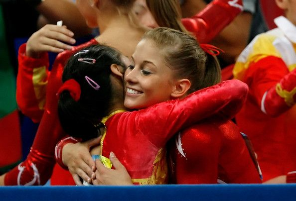 Shawn Johnson of the United States congratulates a member of the women's Chinese gymnastics team after their team final event at the National Indoor Stadium during Day 5 of the Beijing 2008 Olympic Games on August 13, 2008 in Beijing, China.