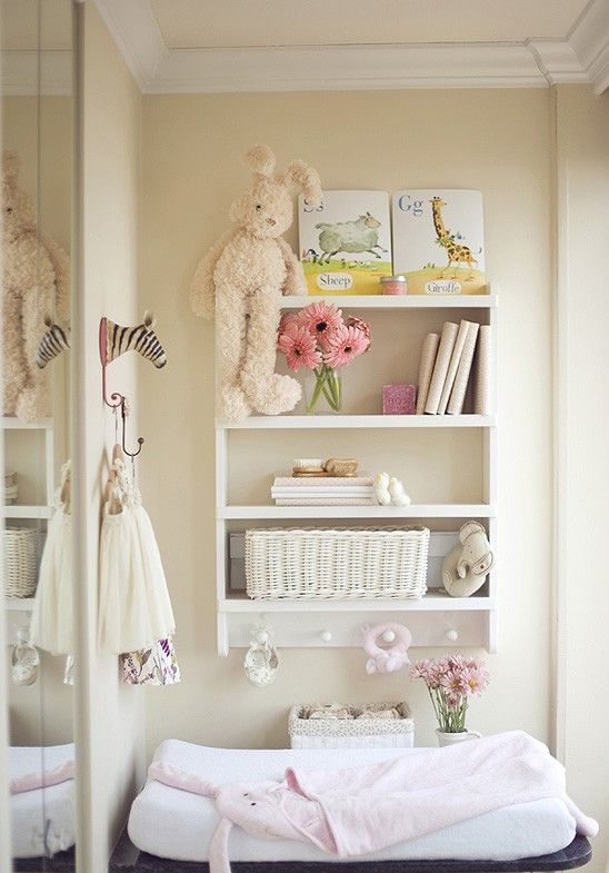 love the shelf over the changing table instead of shelving under it, now that Brody's older he gets into it all, this would change that!! :)