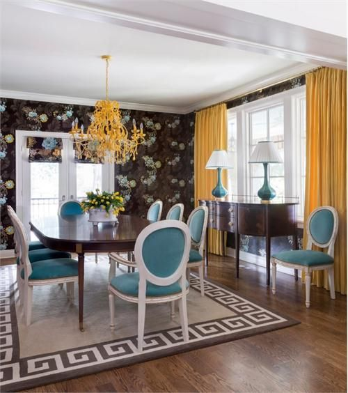 Dramatic Transitional Dining Room with elegant Greek key area rug that pulls colors from both the wood floor and the wall paper.