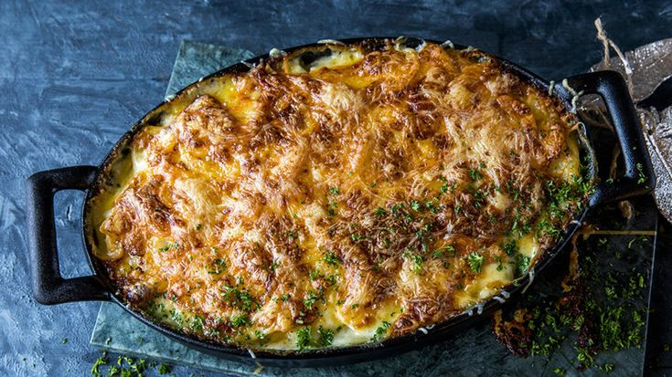 Fløtegratinerte poteter med hvitløk og ost