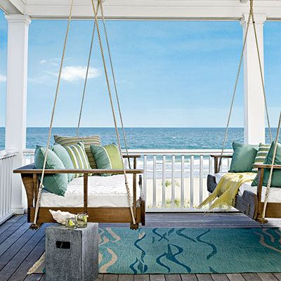 Hanging Beds: From Coastal Living.com- I love having an area outdoors to relax in the breeze and these hanging beds off the master bedroom of this house are perfection.