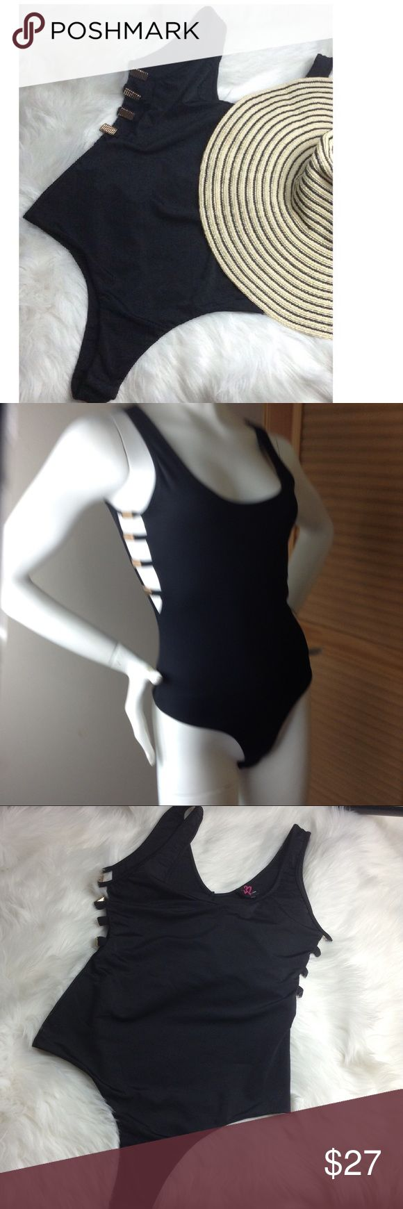 """Bebe Swimsuit Bebe Swimsuit, black ▪️ one piece ▪️ snap closure ▪️ open sides with gold hardware ▪️size tag: petite small (I think it runs large - or size tag is wrong) my mannequin is a 2/4 and its loose on her) ▪️▪chest 28"""", waist 24"""", torso Appx. 27"""" (shoulder to snap closure)️▪️ bundle your ❤️ and save ❤️ bebe Swim One Pieces"""
