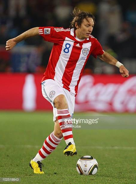 Edgar Barreto of Paraguay runs with the ball during the 2010 FIFA World Cup South Africa Round of Sixteen match between Paraguay and Japan at Loftus...
