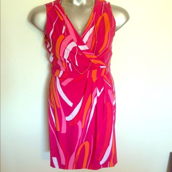 Calvin Klein dress Authentic Calvin Klein dress. This is like new and only been worn once. It has two gold snaps to create a beautiful slimming wrap dress. Calvin Klein Dresses