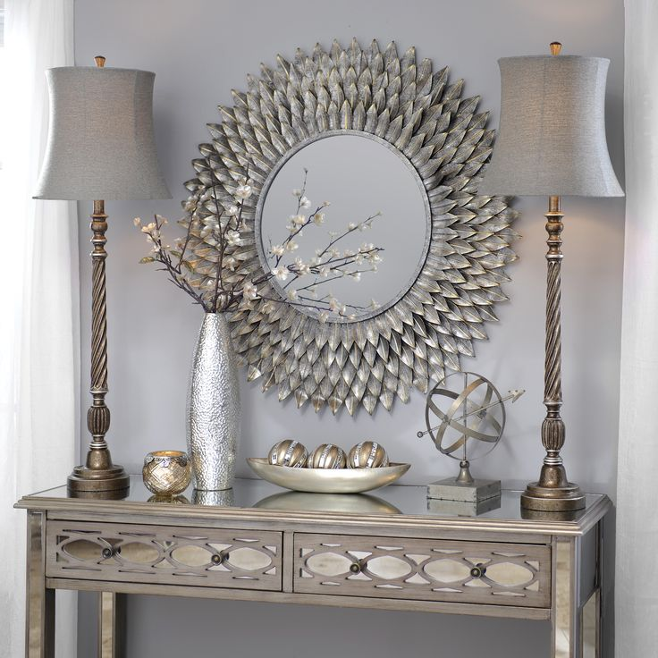 Buffet lamps have small bases and tall, thin bodies. They are perfect for small tables and add height to dwarfed furniture. The Silvis Gunmetal Buffet Lamp features an antique look and looks great with rich, metallic decor.