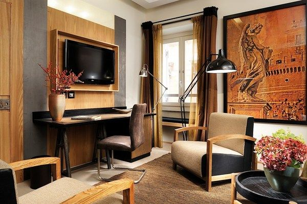Babuino 181 in Rome, Italy - Deluxe Room: A sitting area and a desk let guests relax while enjoying the room's comforts, like the Bose sound system or flat-screen television.
