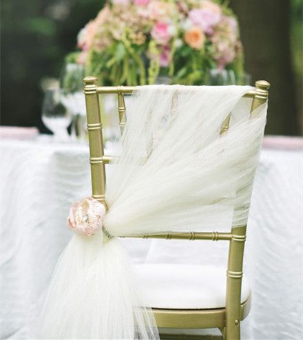 Tulle Chair Decorations - 20 Inspring and Affordable Wedding Chair Decorations - EverAfterGuide