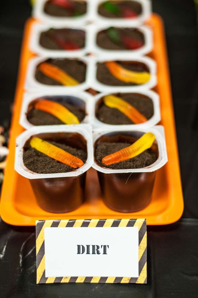 Dirt pudding cups at a construction birthday party! See more party planning ideas at CatchMyParty.com!