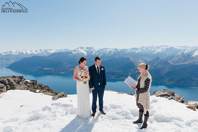 Spring elopement,Queenstown,snowy wedding ceremony.Bride & Groom have Destination Heli weddings Queenstown.