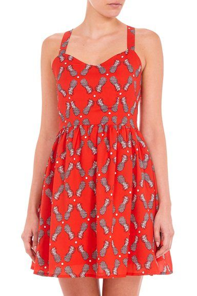 A floaty, flirtly summertime classic sundress featuring a pineapple and polka dot print. This stunning, vibrant red dress will have everyone green with envy.  This flattering, fitted SS14 dress is ideal for every summer time occassion; picnics, BBQs or enjoying a glass of Pimms at Wimbledon.