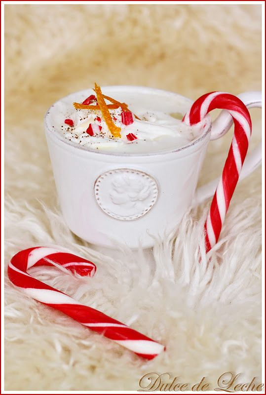 Christmas White Hot Chocolate    The recipe is not in English.  This is the closest translation I could get.  Makes about 8 cups    250 ml whipping cream  6 cloves  3 cinnamon sticks  6 cups milk  300 g white chocolate  peel of 2 oranges  pinch of nutmeg    Place Cinnamon and cloves in a pot. Pour in milk and add chocolate, orange rind, nutmeg and bring to a boil, cook about 3 minutes, and then strain through a sieve. Pour into cups and top with whipped cream, orange peel, cinnamon, or…