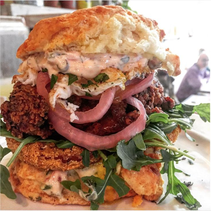 Biscuit of the Day~ Fried chicken, French remoulade, fried green tomatoes, pickled red onions, baby arugula, egg over easy from The Wandering Goose, Seattle