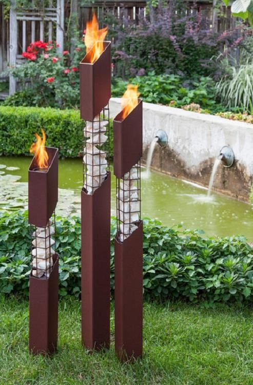 The Mason outdoor torches are constructed of heavy gauge, welded steel and natural stone. The stepped height of each torch is intentionally engineered to lend harmony to any design aesthetic. Heavy, earth-tone, powder-coating is engineered to provide years of corrosion-free use.