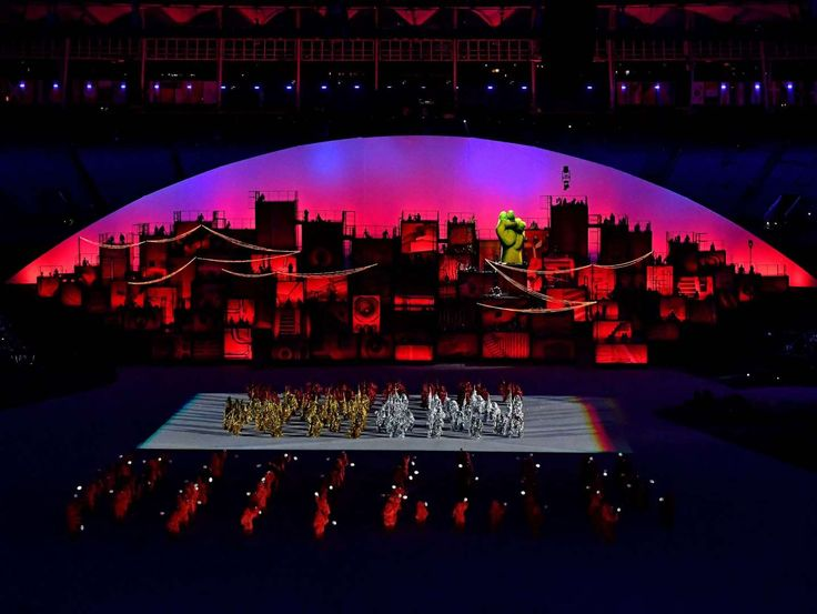 Performers dance during the opening ceremonies for the Rio 2016 Summer Olympic Games at Maracana.     -  Olympics: Opening Ceremonies