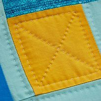 Learn how to hand quilt with this tutorial. There's just nothing quite as special something that is hand quilted. I have two quilts that were made at quilting bees 75 to 100 years ago. The quilts are made out of old flour and feed sacks. These quilts were made with love, a few pricked fingers and lots of laughs by my Grandmother and her friends. You just can't replace a treasure like these!