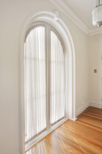 Custom Sheer Curtains adding a soft filtered light to the room.