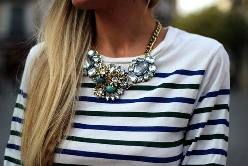 Striped shirt and statement necklace.