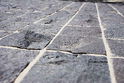 Hand-split-faced bluestone cobbles add textural detail to an otherwise flat surface.