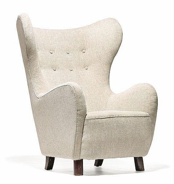 Buy online, view images and see past prices for Kay Fisker: Rare high-back wing chair with legs of stained wood. Sides, back and seat upholstered with beige fabric, back fitted with buttons.. Invaluable is the world's largest marketplace for art, antiques, and collectibles.