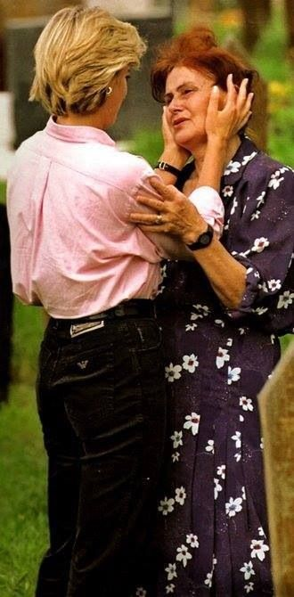 Princess Diana..1997..consoling a Bosnion woman at a cemetery..on her last trip..