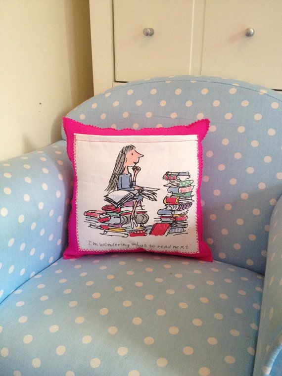 A lovely cushion for a real bookworm! Bright cerise pink wool felt with Roald Dahl Matilda fabric pocket, could be used as a handy little storage
