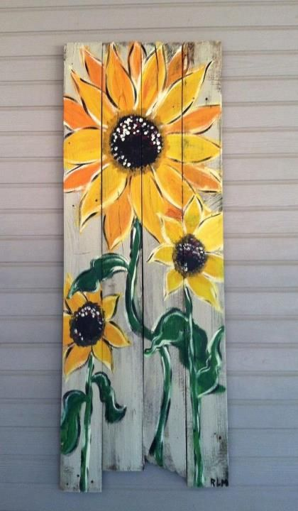 Sunflower wall panel made from old fence boards!