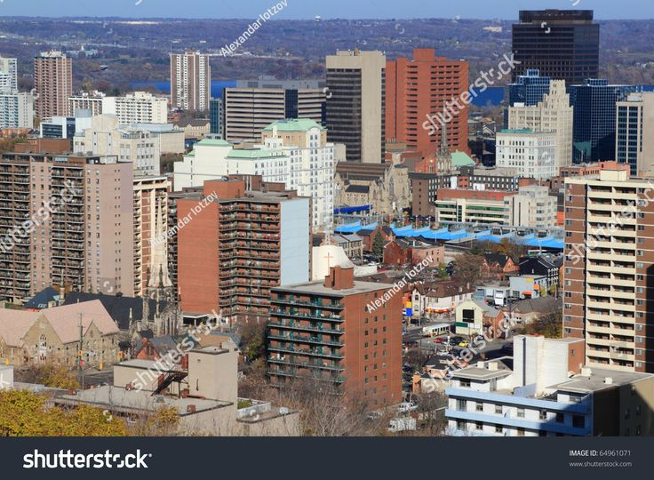 Aerial view of downtown Hamilton, Ontario, Canada, with Lake Ontario on background and surrounding forest. Horizontal orientation.
