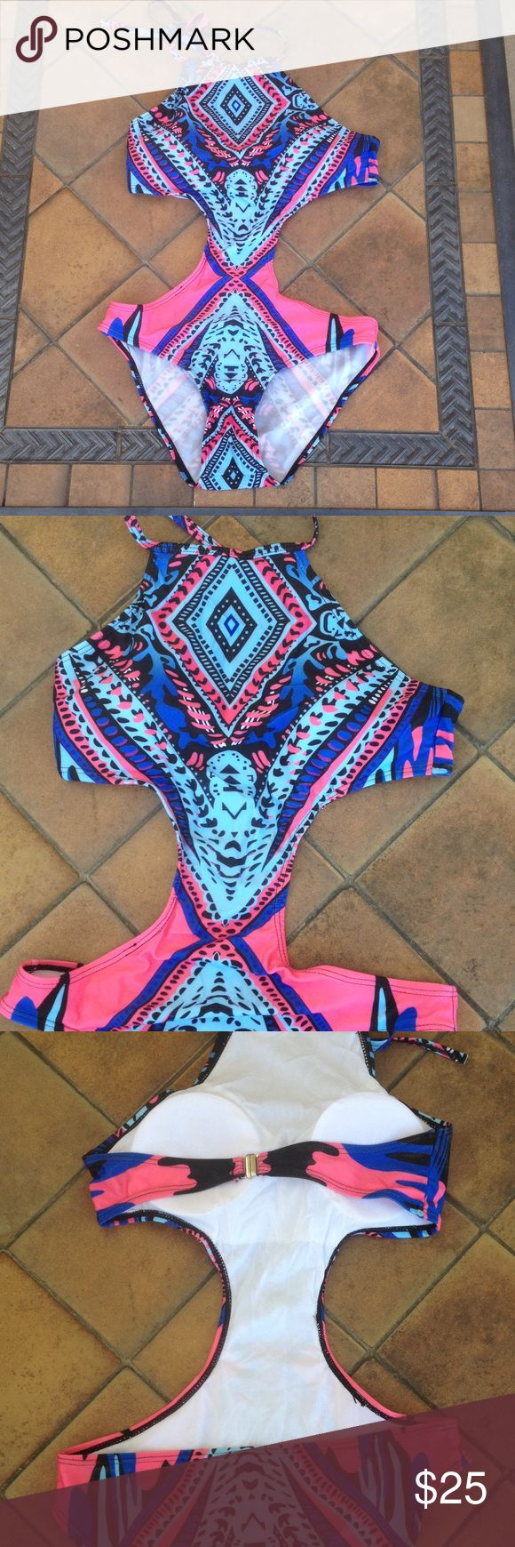 Aztec print cut out minimize one piece bikini Aztec print cut out minimize one piece bikini. Super cute!! My torso is too long. Has a halter top. Has built in pads that will fit an A-B cup. Pink and blue Aztec print. Never worn No brand Swim One Pieces