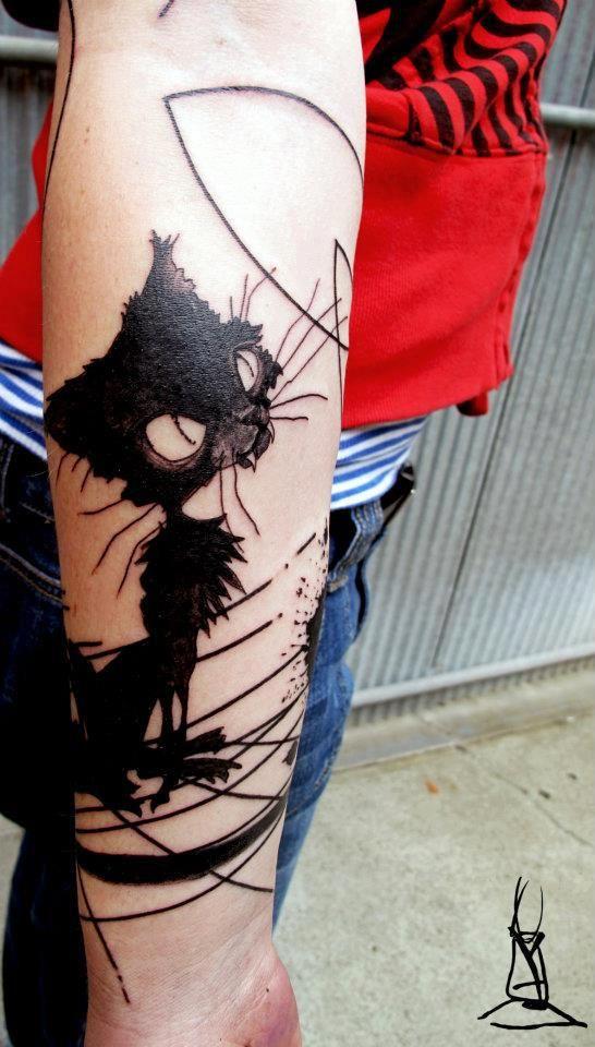 Tatouage chat noir.