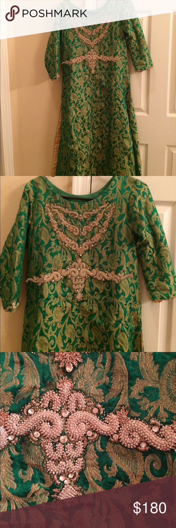 Women dress Beautiful party dress for women stitched in medium size. Pure stuff is used in it and it has stone work on top front and sleeves. Green and gold shirt, green plain trouser and green chiffon pure scarf. Worn only one looks like new. Feel free to ask sizing questions before buying. Dresses