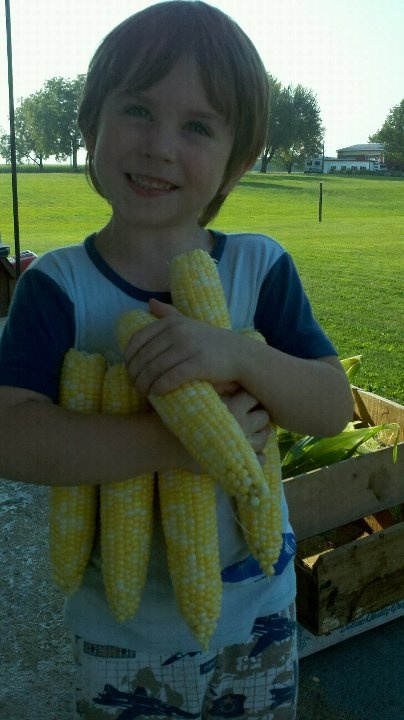 Ethan ... Youngest Grandson (Summer of 2011 helping Papa harvest corn.)
