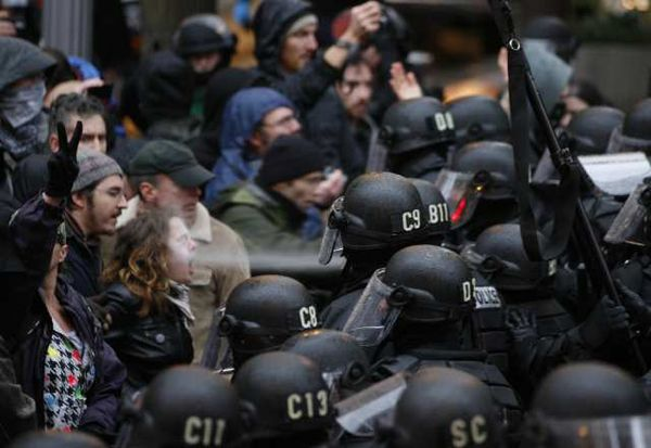 Young woman getting a blast of pepper spray at Occupy Portland by Randy L. Rasmussen