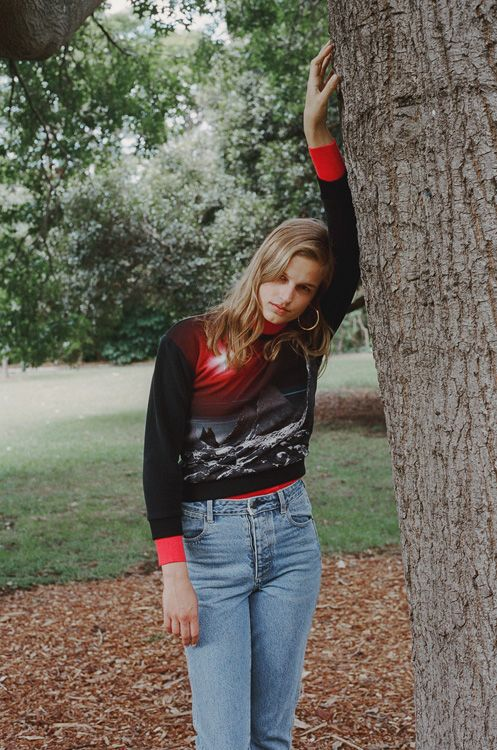 Lisa in Sydney wearing a Lacoste jumper and top (worn underneath), Wrangler jeans and Reliquia earrings for COOL PRETTY COOL