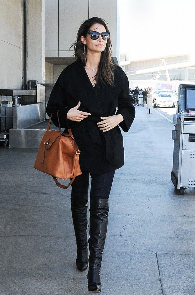 Lily Aldridge adds a touch of color to her monochrome black look with a camel-hued handbag. // #Celebrity