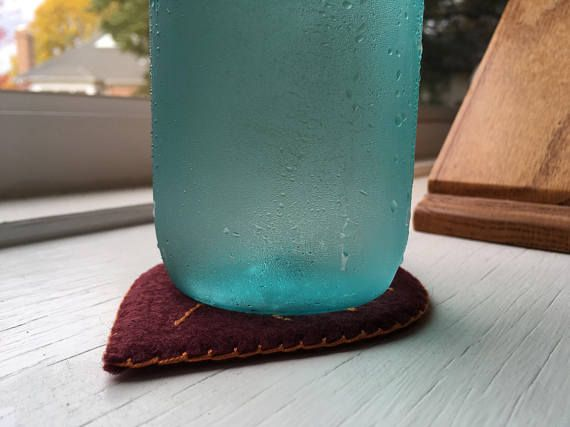 ~ Felt Leaf Coasters ~ Includes 4 felt/cork coasters as shown - one of each color. The felt used is a Merino wool blend. The inner layer is a flexible cork sheet that is then encased with hand stitched felt. - Please allow 3-5 days processing time. - Items ship from the US. No