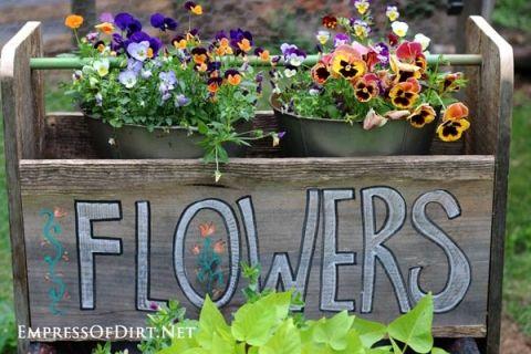 DIY wheelbarrow garden trug made from repurposed wood. Use it as a tool box or flower planter!