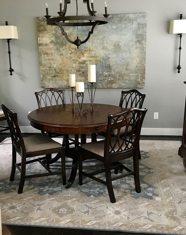 Oushak brings a relaxed atmosphere to this dining room space through elements of cool colors and an all over stylized design.  Artistic surroundings...  http://www.nilipour.com #nilipourorientalrugs #happycustomer #artyoucantreadon #vintage #Oushak #rug #arearug #scotchgard #Birmingham #Alabama #Homewood #shoplocal #naturalfibers #wholesaleprices #quality #directimporting #affordableluxury #functionality #practicality #appeal #investment #conversationpiece #Lifestyle