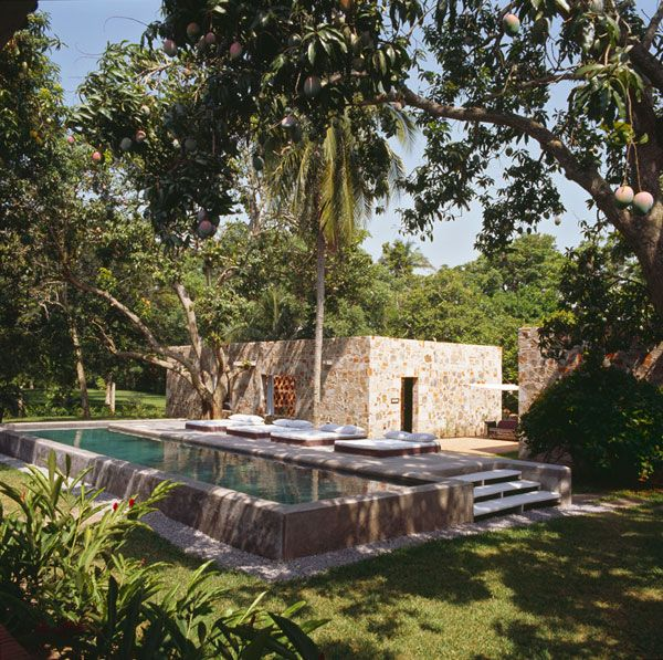 Love this pool on a raised up stone platform. The river rock edging is gorgeous too!