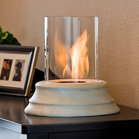 I am in love with this Mediterranean Tabletop Fireplace - has a cast concrete base and hurricane glass, burns gel fuel.
