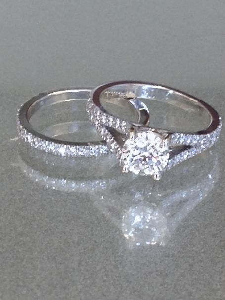 1.00 carat Round Brilliant Cut Diamond Engagement with a pave set split shank setting and matching wedding band