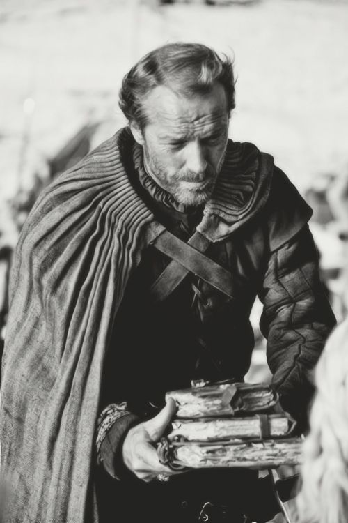 Iain Glen as Ser Jorah Mormont presenting his wedding present to Daenerys in the 2011 HBO medieval fantasy tv series 'Game of Thrones.' Image from 'photo gallery' at link.  More on the series:   http://en.wikipedia.org/wiki/Game_of_Thrones_(TV_series)  A gift of books.