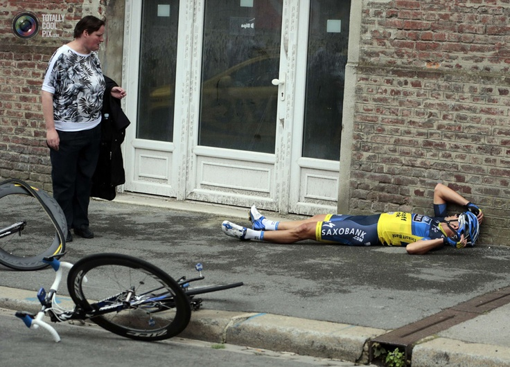 Team Saxo Bank rider Cantwell of Australia lies on the ground after a fall during the fifth stage of the 99th Tour de France cycling race between Rouen and Saint-Quentin. POOL/REUTERS99Th Tours, France Tours, Sports Photos, France 2012, France Cycling, Australia Lying, Cycling Racing, Things Cycling, Sports Pictures
