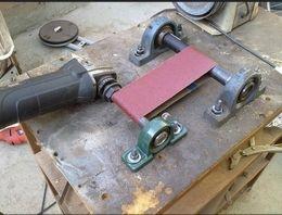 Notcher Grinder Homemade notcher grinder constructed from pillow bearings, shafting, a sanding belt, and an angle grinder